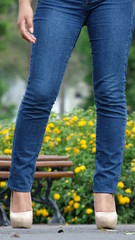 Female Legs Blue Jeans And High Heels