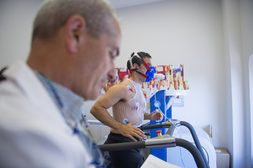 Man doing a stress test of the heart running on a machine