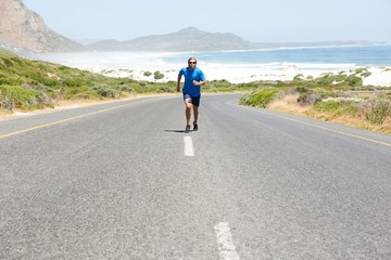 Athlete running on road