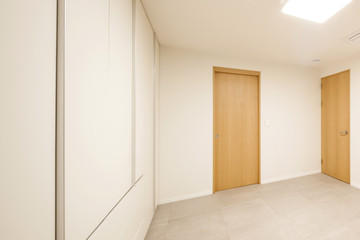 white empty room with wardrobe close for cleaning.