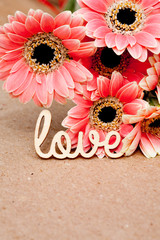 Love with pink flowers with natural paper background
