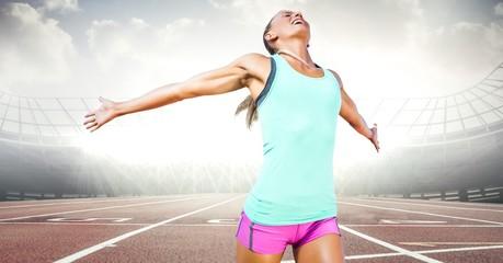 Female runner on track against flares