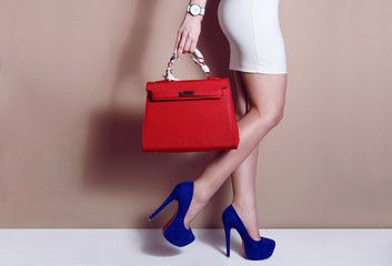 Wall Mural - Close up woman in dress legs high blue heels with red handbag