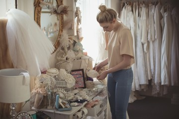 Young woman selecting various accessories