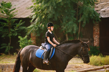 the boy on horseback . Horse riding