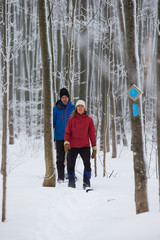 Couple snow shoes in the forest in the winter