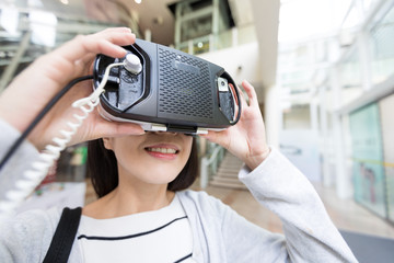 Woman try on virtual reality in shopping mall