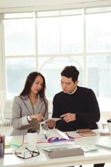 executives discussing over digital tablet at desk