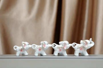 Figures of elephants, family, hold on to each other