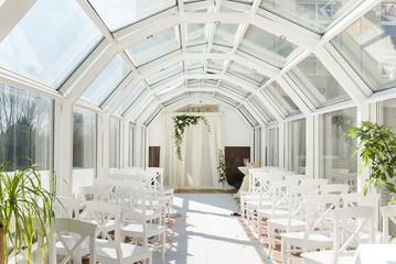 White wedding ceremony decorations indoor. Wedding when bad weather