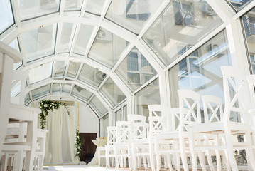 White wedding ceremony decorations indoor. Wedding when bad weather