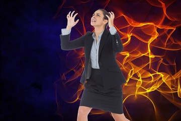 Digital composite image of angry businesswoman with fire
