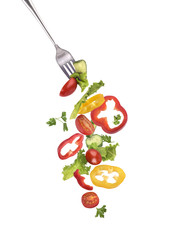 Salad on a fork on a white background
