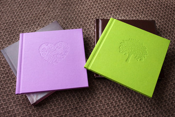 Photo book with textile cover.  Violet and green colors with decorative stamping.