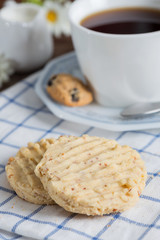 Homemade almond cookies with a cup of coffee.