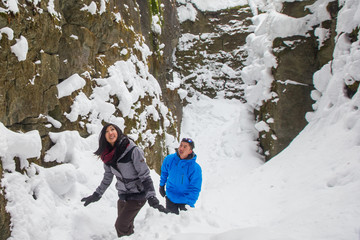 Asian couple hiking in the winter