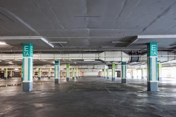 Empty parking garage underground interior in supermarket.