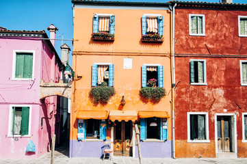 Beautiful street in Veneto, Burano Island. A lot of colorful old houses with a channel in the middle