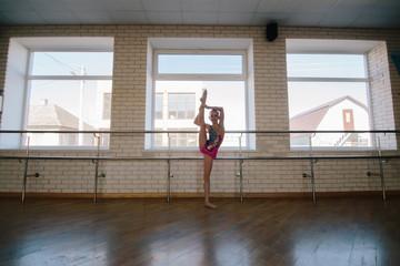 A modern gymnast in a dance class.
