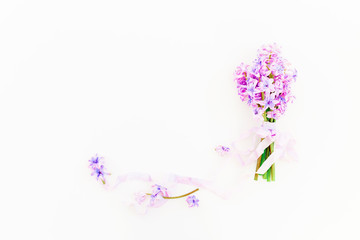 Gentle bouquet of pink hyacinth flowers and tapes on white background. Flat lay, top view.