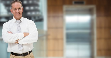 Portrait of confident businessman standing  against building