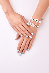 Wall Mural - Beautiful female hands with a flower bracelet.