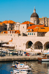 The boat dock near the old city of Dubrovnik, Croatia. The harbor, a marina, near the ancient city.
