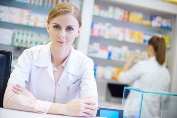 Young pharmacist with arms crossed