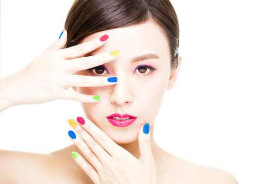 closeup Beauty Girl face with Colorful Makeup concept.