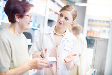 Customer discussing product with pharmacist
