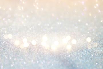 glitter vintage white lights background. de-focused