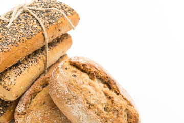 Whole wheat sandwich buns with seeds, on white background.