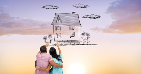 Digital composite image of couple pointing at dream house
