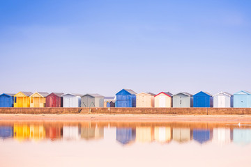 Beach Huts reflected in the water