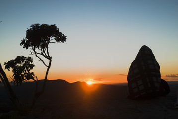 Woman silhouette at sunrise in Brazil