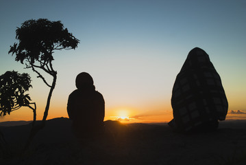 Two women silhouettes at sunrise in Brazil