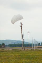 Landing parachutist on the power line.