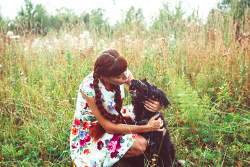 woman on nature with a dog
