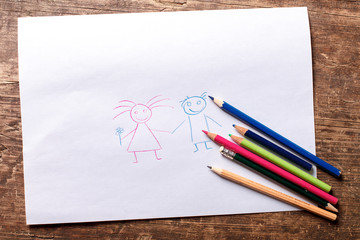 Happy family drawing on white sheet