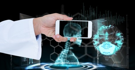 Doctor's hand holding smart phone with skeleton seen through it