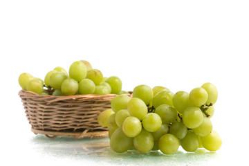 White Grapes into a Basket