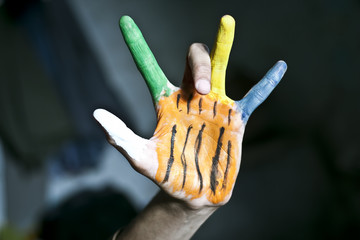 Human hands painted with poster color.