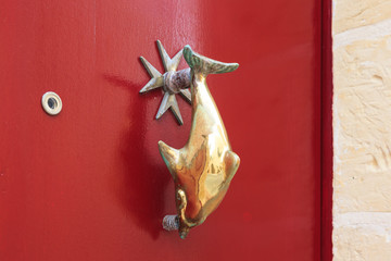 Knocker with dolphin shape. Zurrieq, Malta