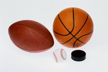 Sports equipmet: football, baseball, basketball,hockey puck,