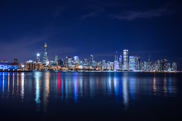 Chicago skyline at night. View on Michigan lake and downtown Chicago. Illinois. USA