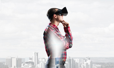 Guy wearing checked shirt and virtual mask with hand on chin