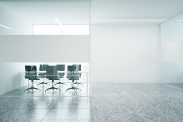Meeting room with blank wall