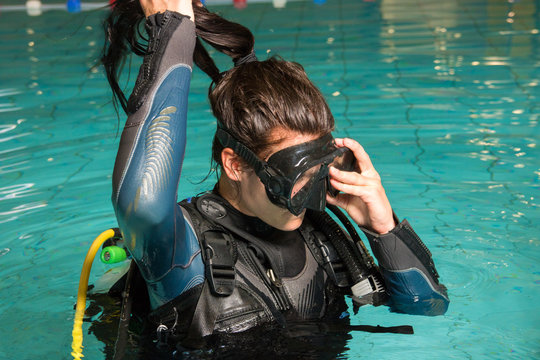 scuba diving course pool teenager girl with instructor