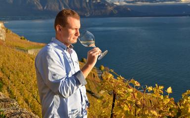 Man holding a glass of wine. Lavaux, Switzerland