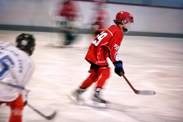 boy playing ice hockey on the rink.
